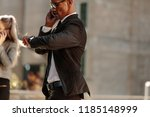 man looking at his wrist watch... | Shutterstock . vector #1185148999