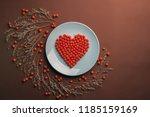 heart of rowan berries on the... | Shutterstock . vector #1185159169