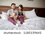happy couple and their cute... | Shutterstock . vector #1185159643