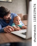 family   young father using a... | Shutterstock . vector #1185159676