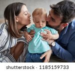 lovely young family   mother... | Shutterstock . vector #1185159733