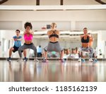 blond female instructor doing... | Shutterstock . vector #1185162139