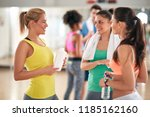 three young women talking and... | Shutterstock . vector #1185162160