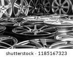 various alloy wheels in store ... | Shutterstock . vector #1185167323