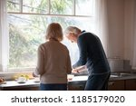 rear view at middle aged loving ... | Shutterstock . vector #1185179020