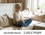 mindful healthy mature woman... | Shutterstock . vector #1185179089