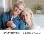 happy affectionate mature old... | Shutterstock . vector #1185179110