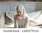 sad lonely middle aged senior... | Shutterstock . vector #1185179113