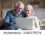 retired couple using laptop... | Shutterstock . vector #1185179176