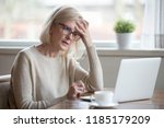 Small photo of Thoughtful confused mature business woman concerned thinking about online problem looking at laptop, frustrated worried senior middle aged female reading bad email news, suffering from memory loss