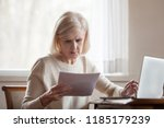serious frustrated middle aged... | Shutterstock . vector #1185179239