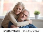 smiling caring middle aged wife ... | Shutterstock . vector #1185179269