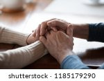 Small photo of Old middle aged people holding hands close up view, senior retired family couple express care as psychological support concept, trust in happy marriage, empathy hope understanding love for many years