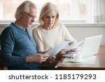 serious worried senior couple... | Shutterstock . vector #1185179293