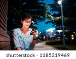 young woman using smartphone in ... | Shutterstock . vector #1185219469