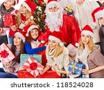 Group people and  Santa holding gift box near  Christmas tree. - stock photo