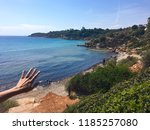 outstretched hand over view of... | Shutterstock . vector #1185257080