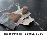 ripped up pieces of sand paper... | Shutterstock . vector #1185276010