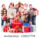 Group people  holding gift box near  Christmas tree. - stock photo