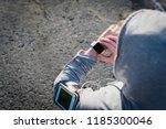 smartwatch woman athlete using... | Shutterstock . vector #1185300046