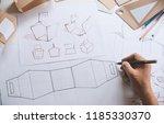 designer sketching drawing... | Shutterstock . vector #1185330370