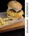 big burger with egg omelette ...   Shutterstock . vector #1185368413