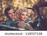 retro couple in convertible | Shutterstock . vector #118537138