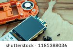 button cell phone disassembled... | Shutterstock . vector #1185388036
