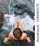 a girl on a stony beach  | Shutterstock . vector #1185404170