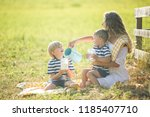 young pretty mother having... | Shutterstock . vector #1185407710