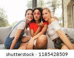 female young friends hanging... | Shutterstock . vector #1185428509