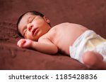 a cute two weeks old newborn... | Shutterstock . vector #1185428836