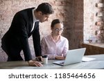 businesswoman explains task to... | Shutterstock . vector #1185464656