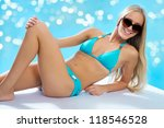 Beautiful blond woman on the beach - stock photo
