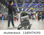 young asian man holding cart of ... | Shutterstock . vector #1185474193