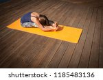 young  woman in bodysuit... | Shutterstock . vector #1185483136