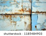 a rusty wall. blue and white... | Shutterstock . vector #1185484903