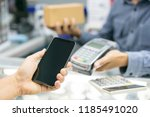 customer paying with nfc... | Shutterstock . vector #1185491020