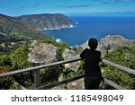 tourist observing the cliffs of ... | Shutterstock . vector #1185498049