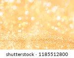 abstract background gold light... | Shutterstock . vector #1185512800
