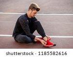 athlete sprinter getting ready...   Shutterstock . vector #1185582616