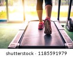 the girl's legs are jogging on...   Shutterstock . vector #1185591979