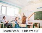 kids having fun in school yard...   Shutterstock . vector #1185595519