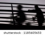 a man is walking behind a child ... | Shutterstock . vector #1185605653