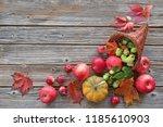 cornucopia with autumn harvest... | Shutterstock . vector #1185610903