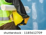 the male engineer holding a... | Shutterstock . vector #1185612709