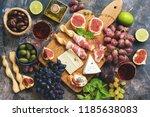 a variety of snacks  prosciutto ... | Shutterstock . vector #1185638083