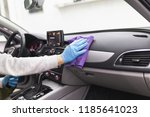 A man cleaning car interior, car detailing (or valeting) concept. Selective focus.  - stock photo