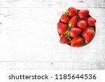 ripe strawberries forest fruits ... | Shutterstock . vector #1185644536