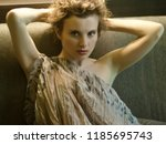 beautiful and femme fatale in a ... | Shutterstock . vector #1185695743